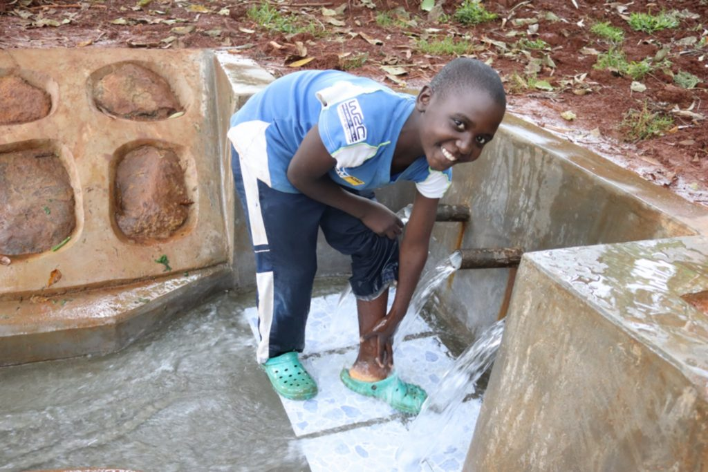 The Water Project : kenya21033-john-cleaning-his-feet