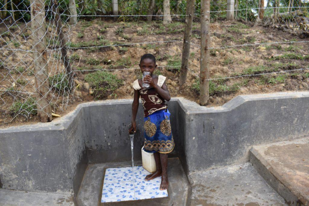The Water Project : kenya21039-monika-drinking-clean-water-3