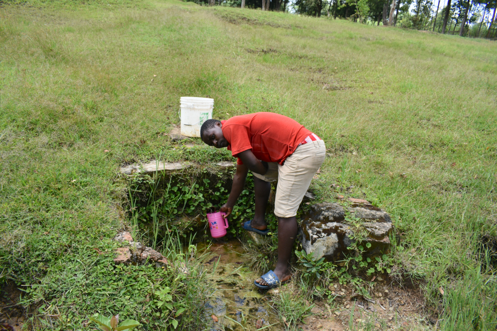 The Water Project : kenya21062-collecting-water-1-2