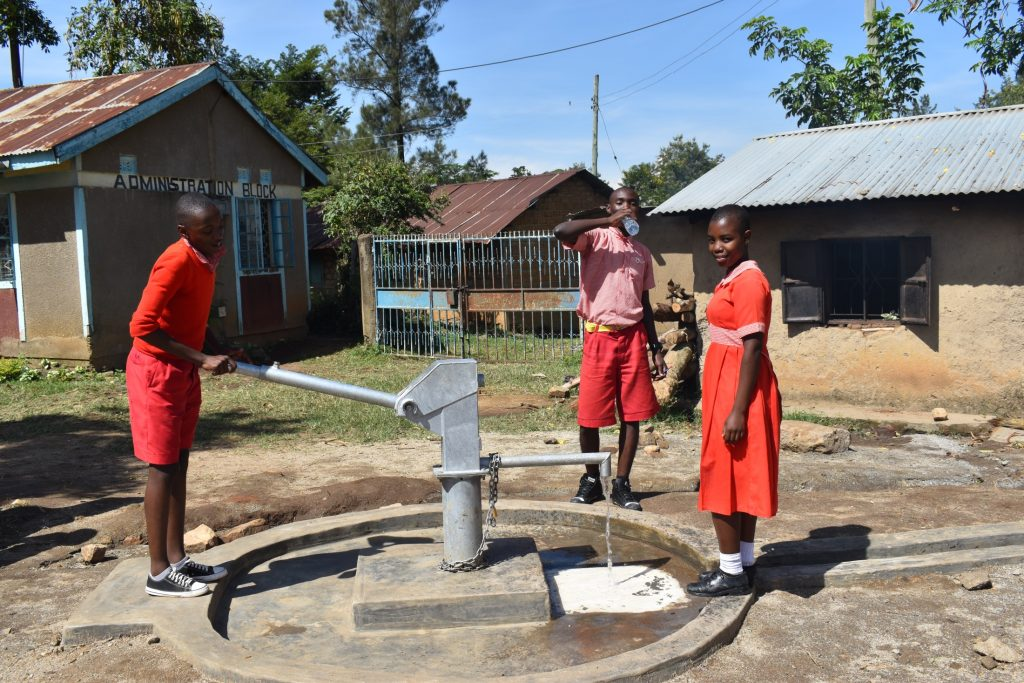 The Water Project : kenya21202-students-pump-the-well-6