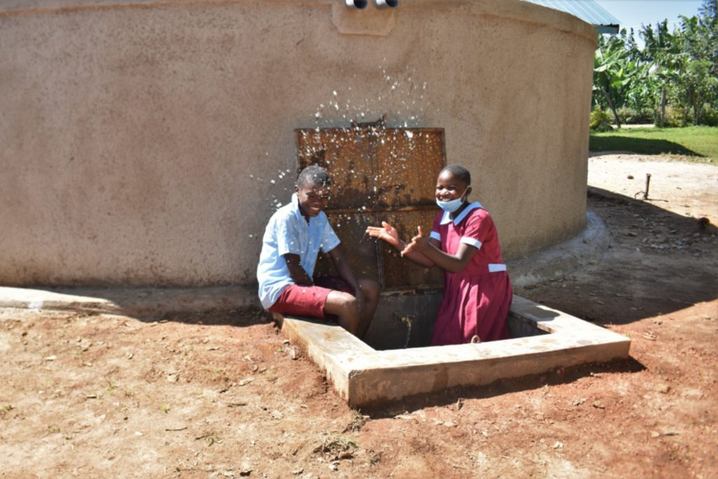 The Water Project : kenya21233-children-playing-with-water-3