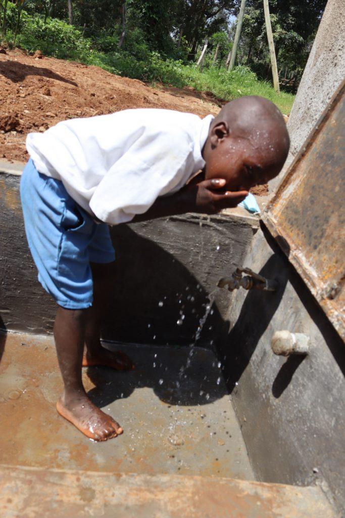 The Water Project : kenya21240-pupil-washing-his-face