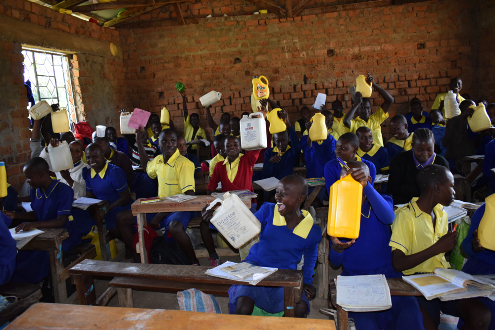 The Water Project : kenya21250-students-show-their-water-containers-6