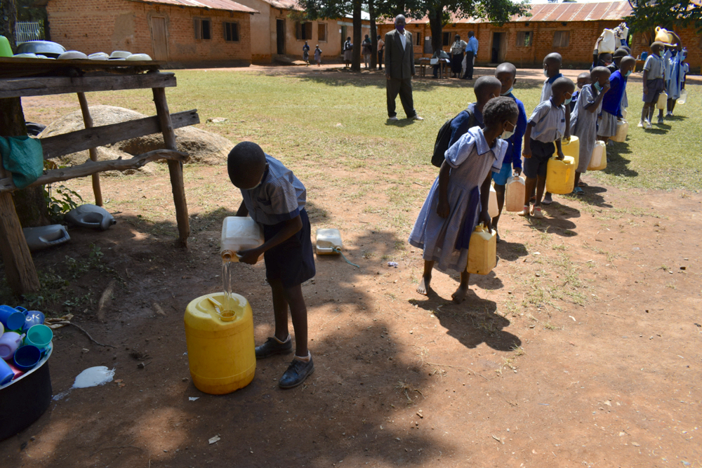 The Water Project : kenya21254-delivering-water-to-school-kitchen-1-3