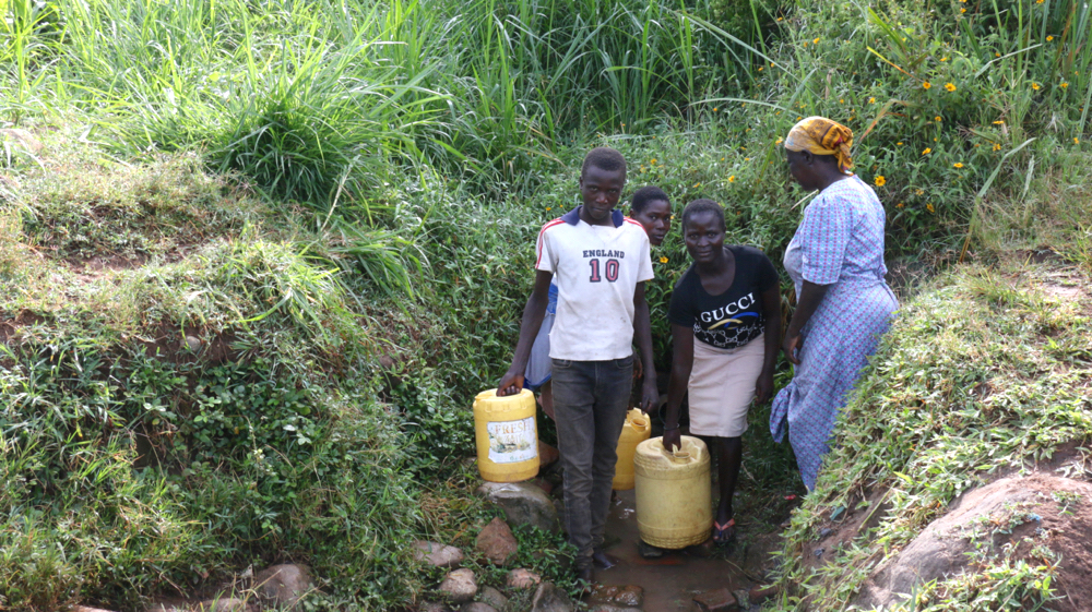 The Water Project : kenya21313-people-at-the-spring-2