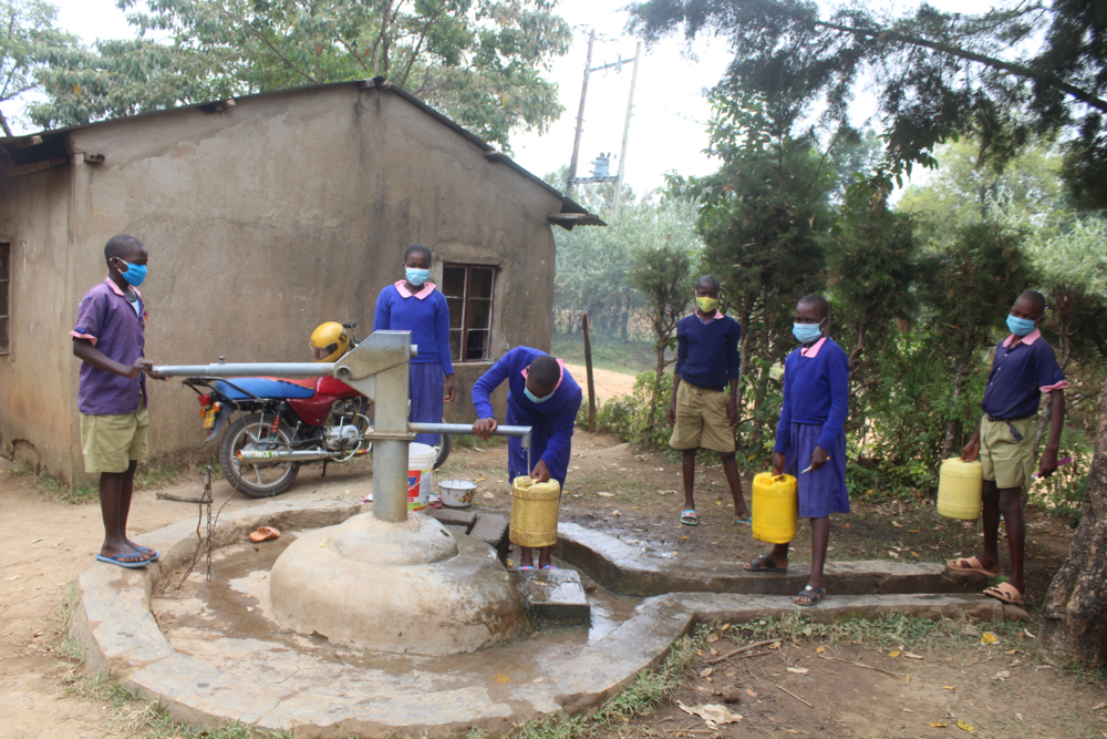 The Water Project : kenya21355-students-collecting-water-2-2