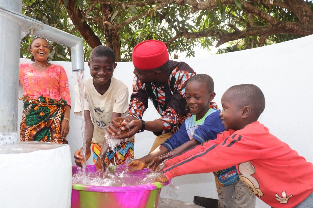 The Water Project : sierraleone21522-ward-councilor-and-kids-celebrate-2