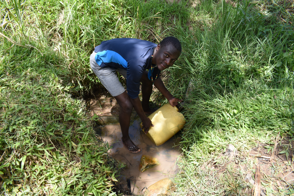 The Water Project : kenya20175-collecting-water-2-2