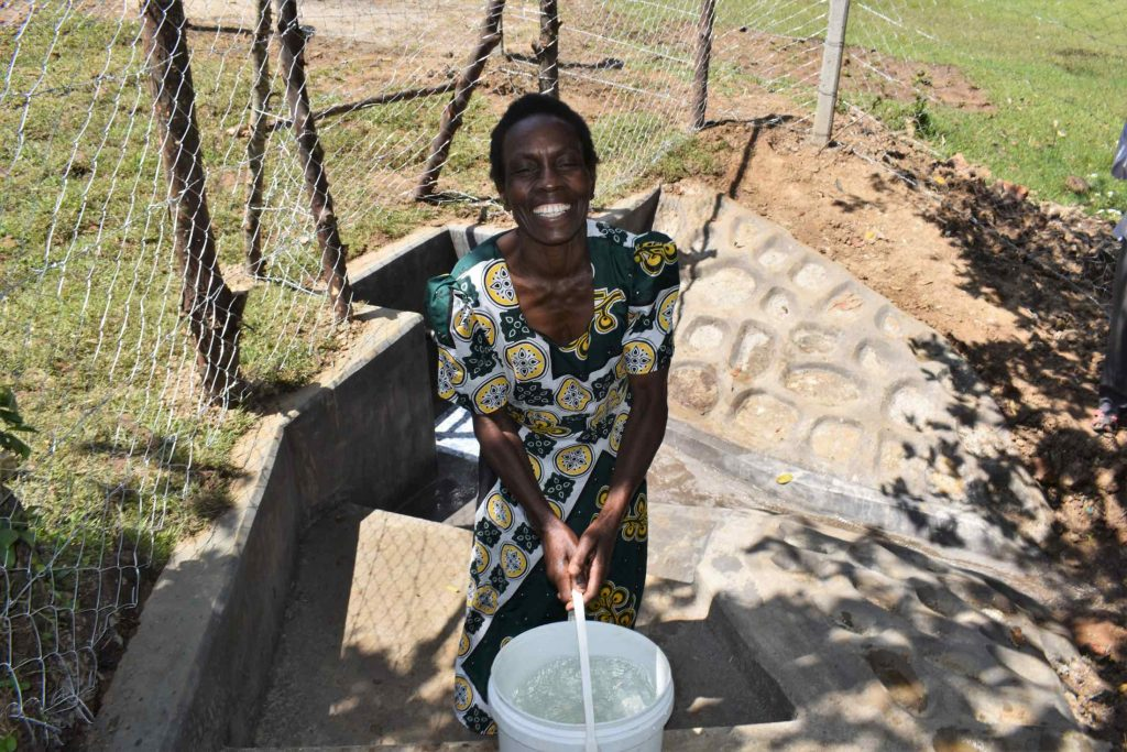 The Water Project : kenya21062-carrying-clean-water