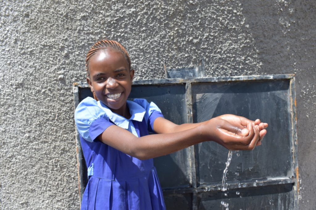 The Water Project : kenya21210-student-celebrates-water