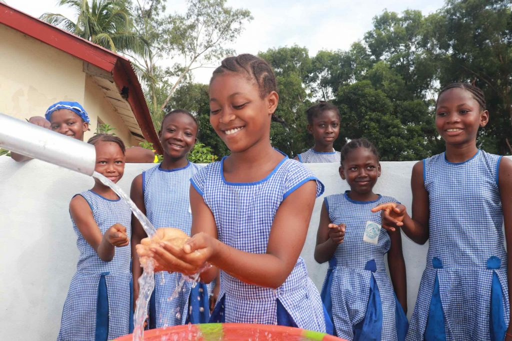 The Water Project : sierraleone21569-student-happily-drinking-1