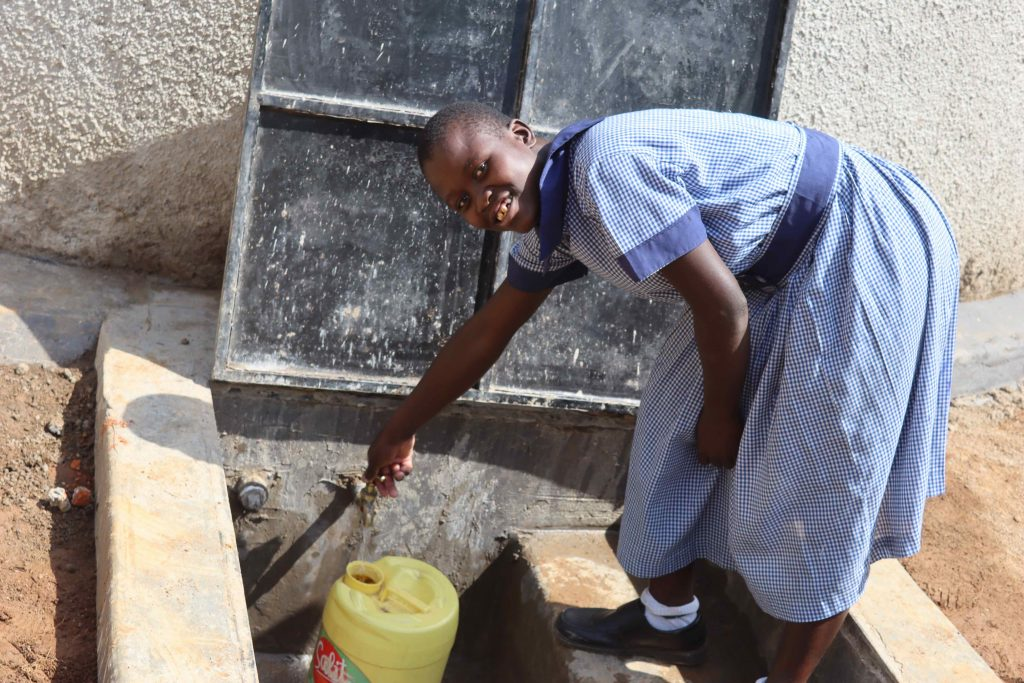 The Water Project : kenya21249-6-students-fetching-water-3