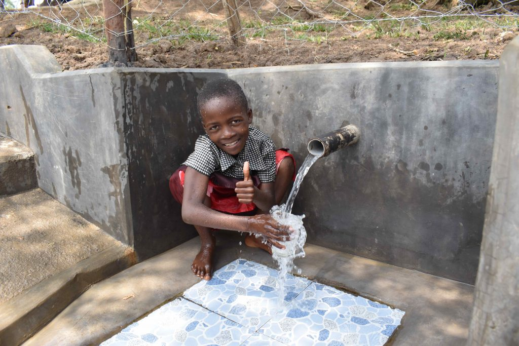 The Water Project : kenya21054-6-enjoying-clean-water-6