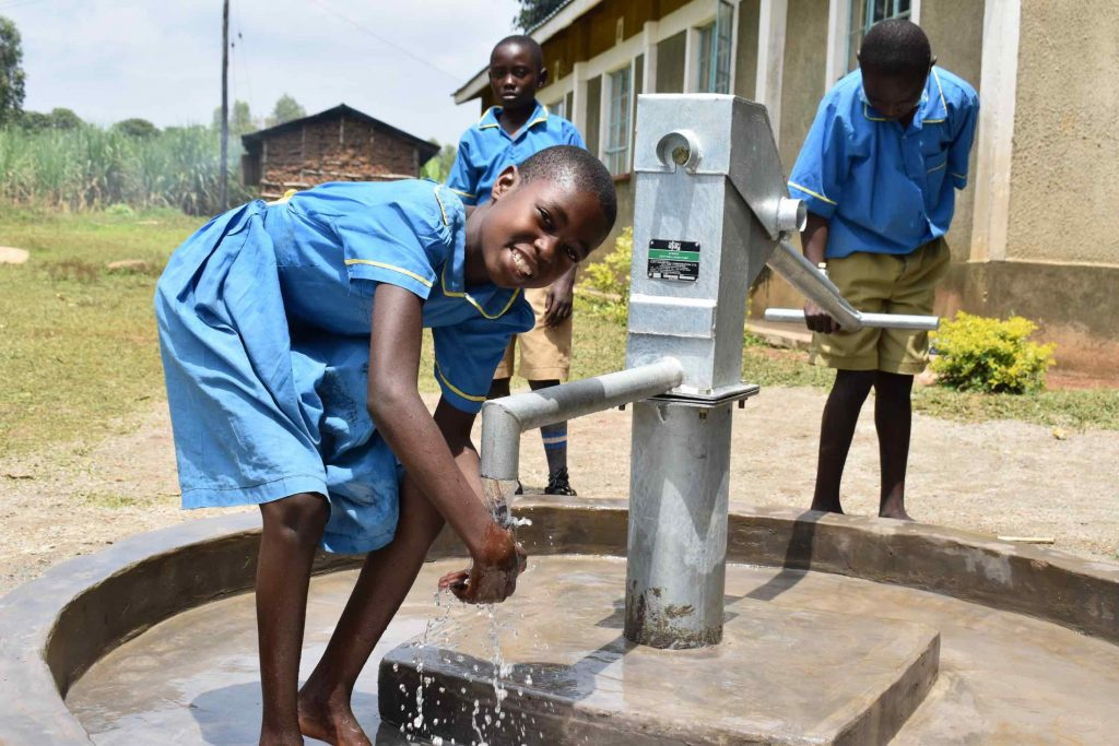 The Water Project : kenya21270-collecting-water-at-the-borehole-2