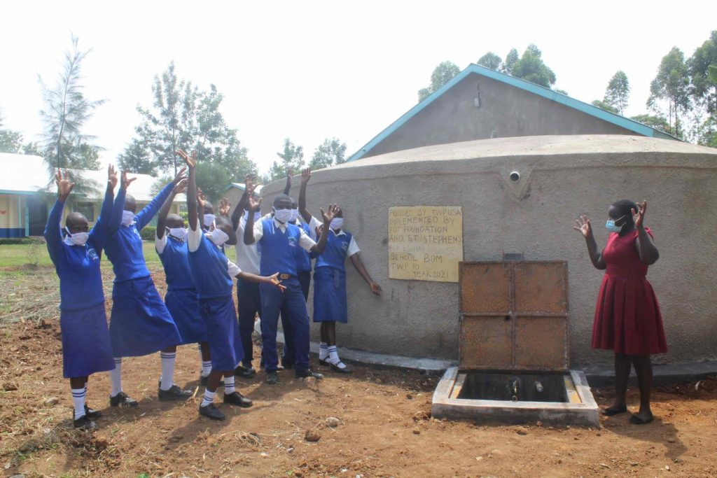 The Water Project : kenya21356-handing-over-the-tank-2