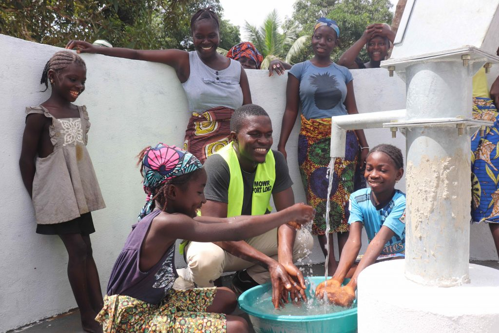 The Water Project : sierraleone21541-kids-and-mr-fofanah-ministry-of-water-resources