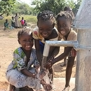 Girls collecting water in Burkina Faso