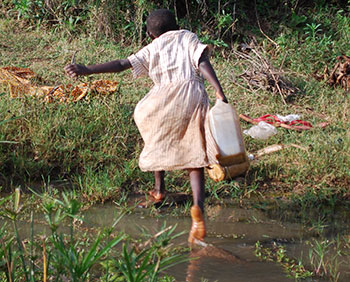 Girl collecting dirty water in Kenya
