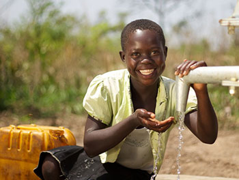 Girl with access to clean water in South Sudan