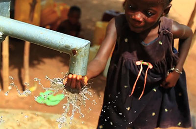 Girl at new well in Sierra Leone