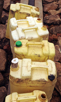 Jerry cans at a well