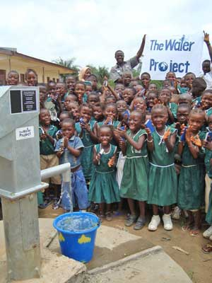 Students celebrate a new well in Sierra Leone