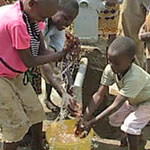 Boys in Kenya playing at new water well