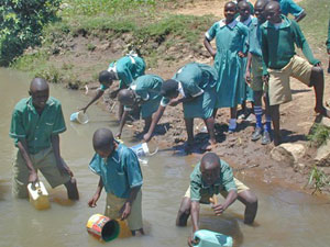 School children collecting dirty water