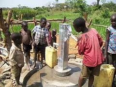 Children playing by their new well